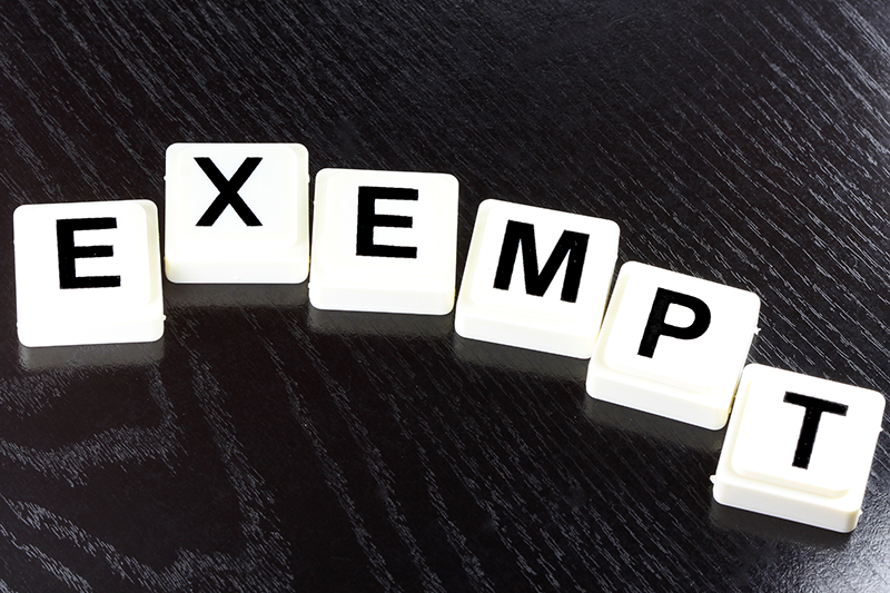 Exempt spelled out in block letters