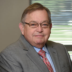 Headshot of Greensfelder attorney Russell K. Scott