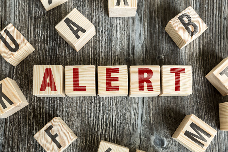 "The word ""alert"" on wooden blocks"
