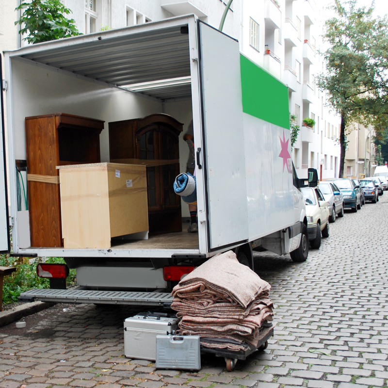 Image of moving van filled with moving boxes