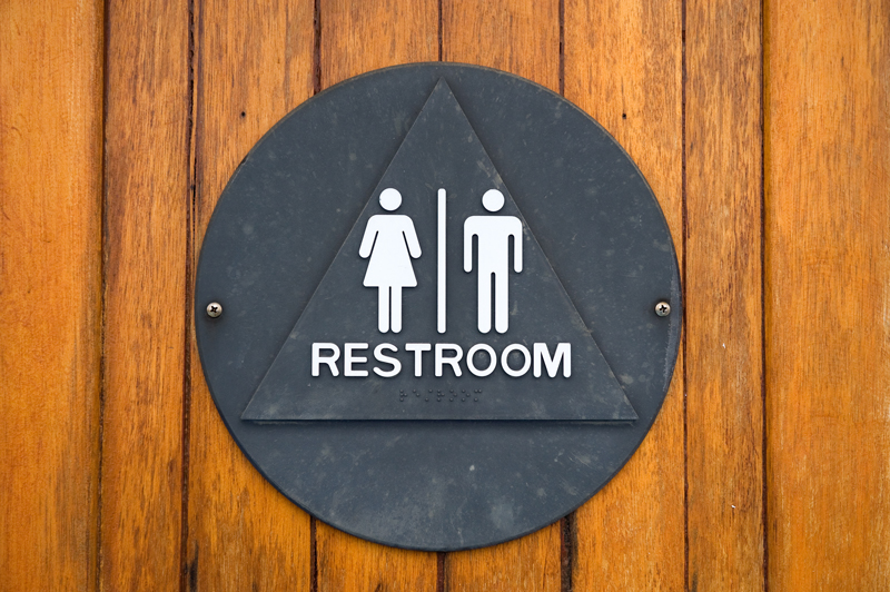 Male and female bathroom sign.