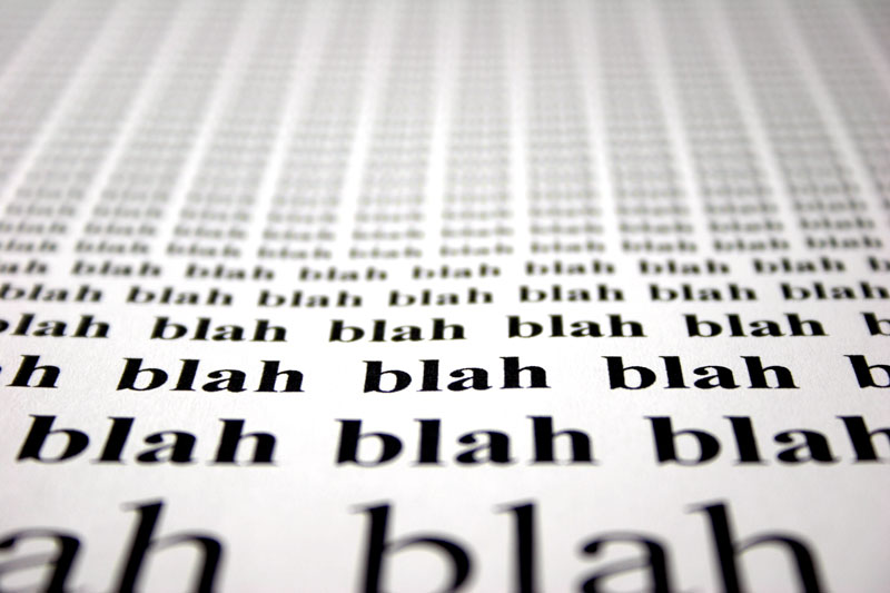 "Word ""blah blah blah"" typed out onto a piece of paper"