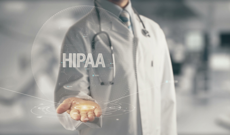 "Doctor holding the word ""HIPPA"""