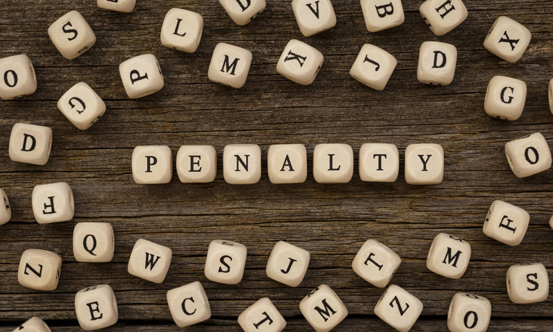 "The word ""penalty"" spelled out with wooden blocks"