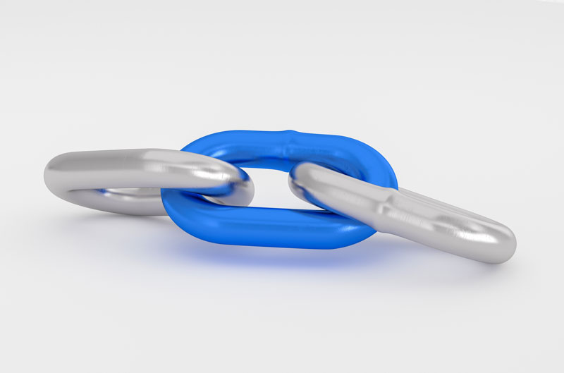 Three links of a chain, with the middle one being blue and the left and right one being silver
