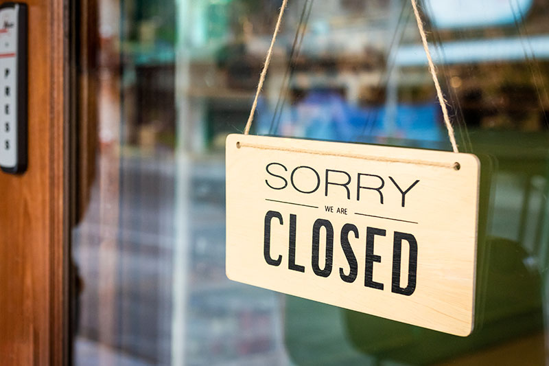 Closed sign on commercial storefront
